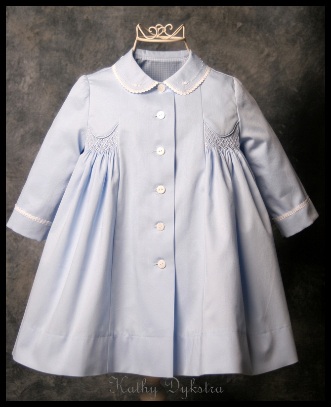 Blue smocked coat
