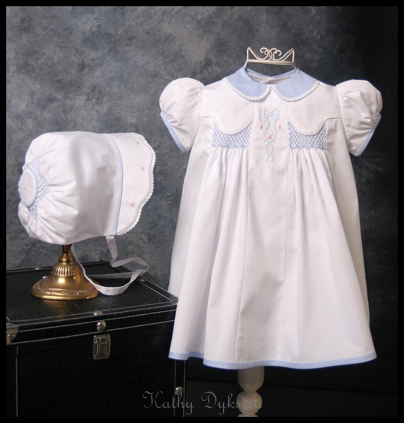 White with blue dress and cap